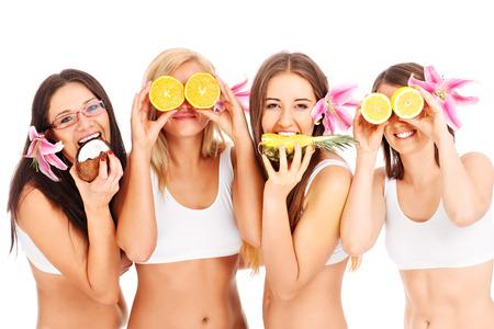 Photo pour Group of young girls with fruits - image libre de droit