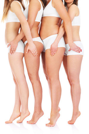 A picture of four female bodys over white background