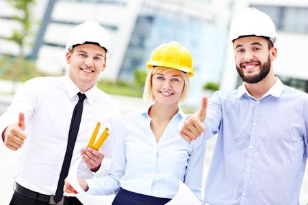 Photo pour A picture of a group of happy architects on site - image libre de droit