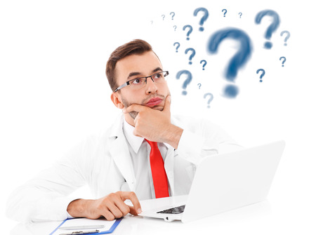 Photo pour A picture of an unhappy doctor with laptop and documents sitting in the office - image libre de droit