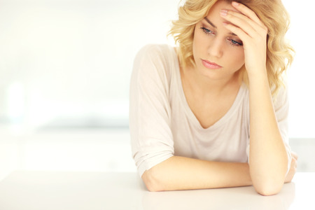 Photo pour A picture of a young depressed woman with headache at home - image libre de droit