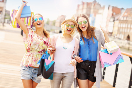 Photo pour A picture of group of friends shopping in the city - image libre de droit