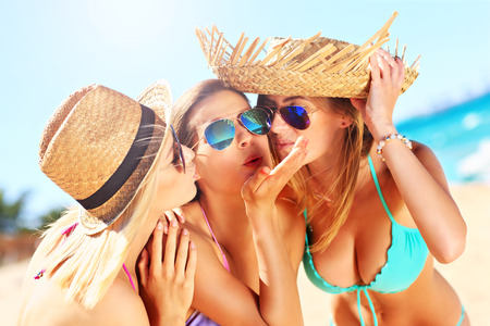 Photo for  a group of women having fun on the beach - Royalty Free Image