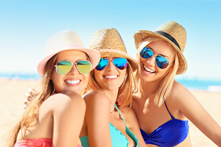 Photo for A picture of a group of women having fun on the beach - Royalty Free Image