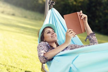 Photo pour Picture of young woman relaxing in hammock - image libre de droit