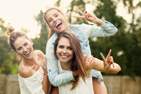 Foto de Picture presenting happy group of women having fun outdoors - Imagen libre de derechos