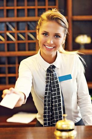 Foto de Picture of receptionist giving key card - Imagen libre de derechos