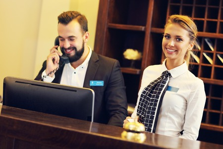 Photo for Picture of two receptionists at work - Royalty Free Image