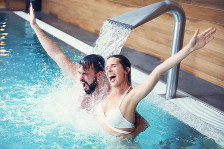 Photo for Picture of happy couple relaxing in pool spa - Royalty Free Image
