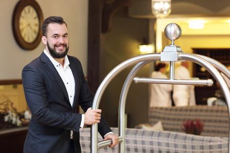 Photo pour Picture of bellboy in hotel - image libre de droit