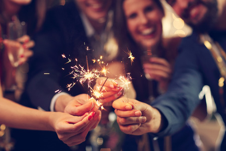 Photo pour Picture showing group of friends having fun with sparklers - image libre de droit