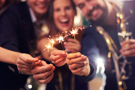 Photo for Picture showing group of friends having fun with sparklers - Royalty Free Image
