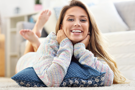 Photo pour Picture showing happy woman relaxing at home - image libre de droit