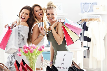 Photo for Group of happy friends shopping in store - Royalty Free Image