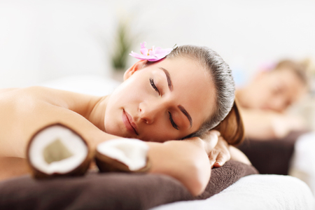 Photo for Two beautiful women getting massage in spa - Royalty Free Image