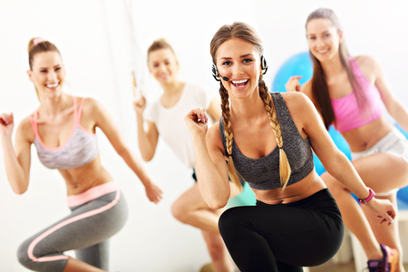 Photo for Group of smiling people doing aerobics - Royalty Free Image
