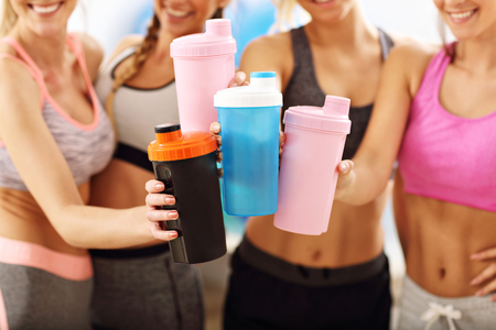 Photo for Young women group resting at the gym after workout - Royalty Free Image