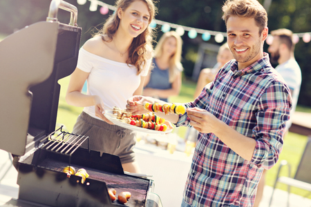 Photo for Friends having barbecue party in backyard - Royalty Free Image