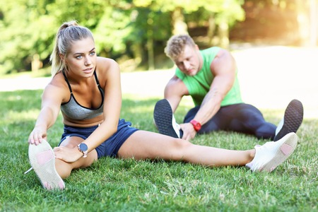 Photo for Young couple working out in park - Royalty Free Image