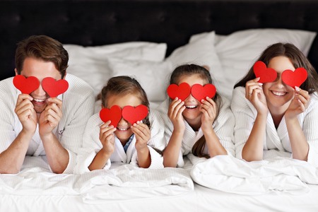 Photo for Happy family relaxing in hotel room - Royalty Free Image