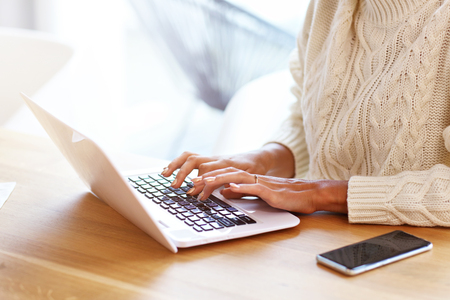 Photo pour Picture of adult woman wearing warm sweater and working at home - image libre de droit