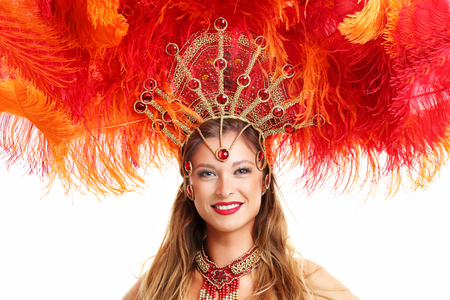 Photo for Brazilian woman posing in samba costume over white background - Royalty Free Image