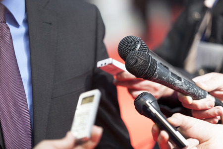 Photo pour A journalist is making a interview with a microphone - image libre de droit