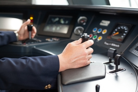 Foto per Railroad engineer. Train driver at the workplace. - Immagine Royalty Free