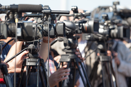 Photo for News conference. Filming an event with a video camera. - Royalty Free Image