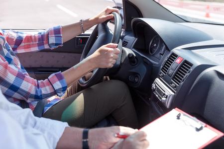 Photo pour Learner driver student driving car with instructo - image libre de droit