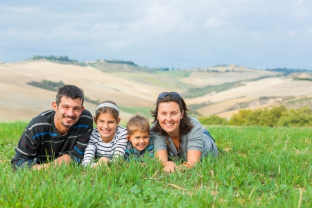 Happy family having fun outdoors in Tuscan