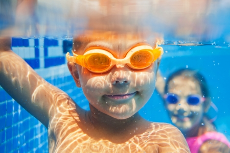 Photo for Close-up underwater portrait of the cute smiling boy - Royalty Free Image