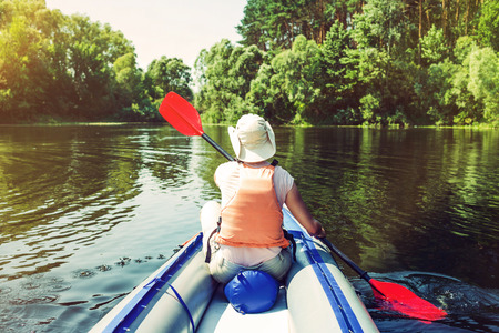 Photo for Woman kayaking on river - Royalty Free Image
