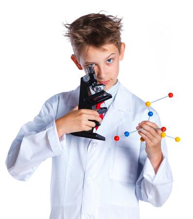 Foto de Little boy scientist in the laboratory. - Imagen libre de derechos
