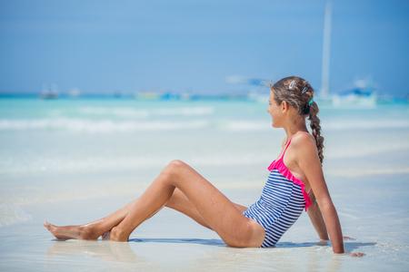Photo pour Girl in bikini lying and having fun on tropical beach - image libre de droit
