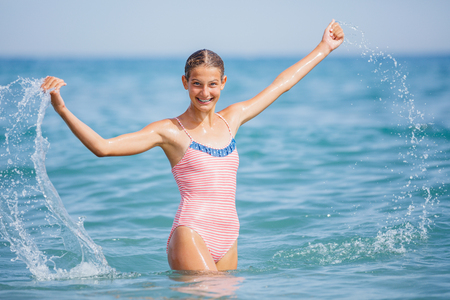 Photo for Girl in swimsuit having fun on tropical beach - Royalty Free Image
