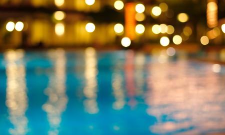 Foto de blur night light reflection in blue waving water - Imagen libre de derechos