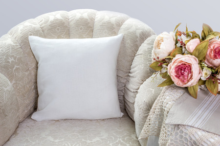 Foto de Pillow case Mockup. White pillow on an armchair in the room. - Imagen libre de derechos