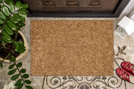 Photo for Blank doormat before the door in the hall. Mat on ceramic floor, flowers and red shoes. Welcome home, product Mockup - Royalty Free Image