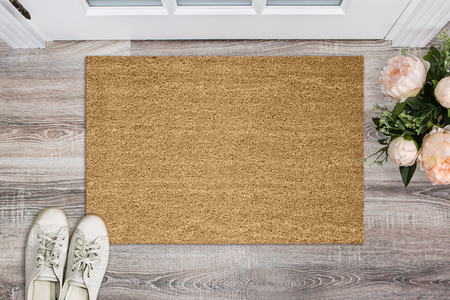 Photo for Blank coir doormat before the door in the hall. Mat on wooden floor, flowers and shoes. Welcome home, product Mockup - Royalty Free Image