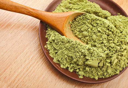 Photo pour Powdered Green Tea Matcha in spoon on wood table surface close up background - image libre de droit