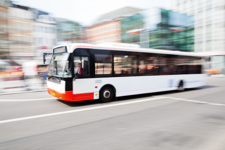 Photo pour driving bus in city traffic in motion blur - image libre de droit