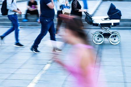 Photo pour People on the move in the city in motion blur - image libre de droit