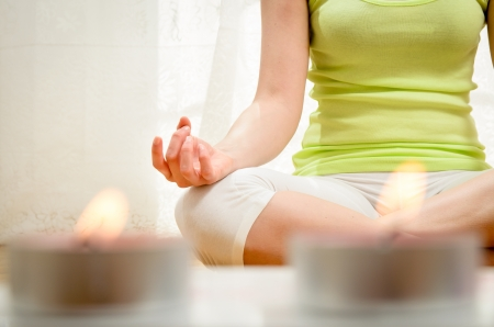 Photo for Beautiful young woman doing yoga exercise and meditating at home. - Royalty Free Image