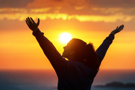 Photo for Free woman raising arms to golden sunset summer sky - Royalty Free Image