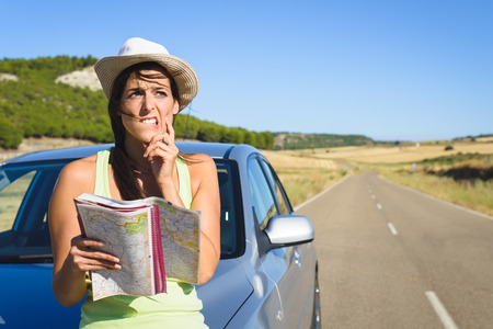 Photo for Confused lost woman on car roadtrip travel problem searching in road map  - Royalty Free Image
