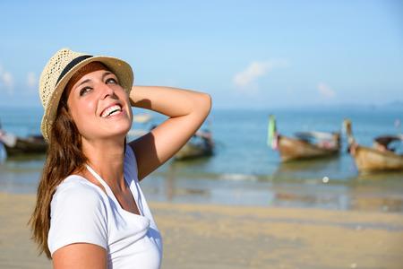 Happy woman enjoying travel vacation to Krabi, Thailand. Joyful brunette having fun and girl smiling on Railay Beach.