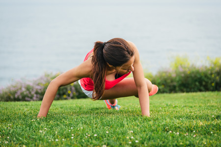 Photo for Fitness woman training core outside. Female athlete exercising on summer or spring. - Royalty Free Image