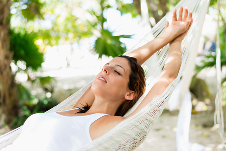 Photo for Relaxed woman napping on hammock. Relaxing tranquility on caribbean vacation. - Royalty Free Image