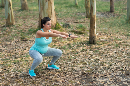 Photo for Fitness pregnant woman doing squats for strengthen pelvic floor muscles and legs. Healthy pregnancy exercise. - Royalty Free Image